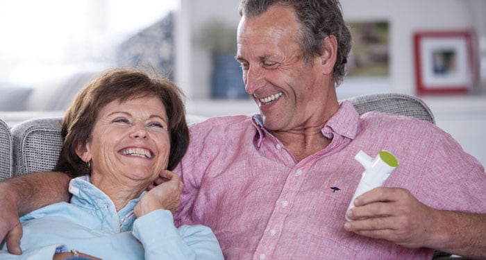 Laughing gentleman enjoying the benefits of the InnoSpire Deluxe and SideStream nebulizer